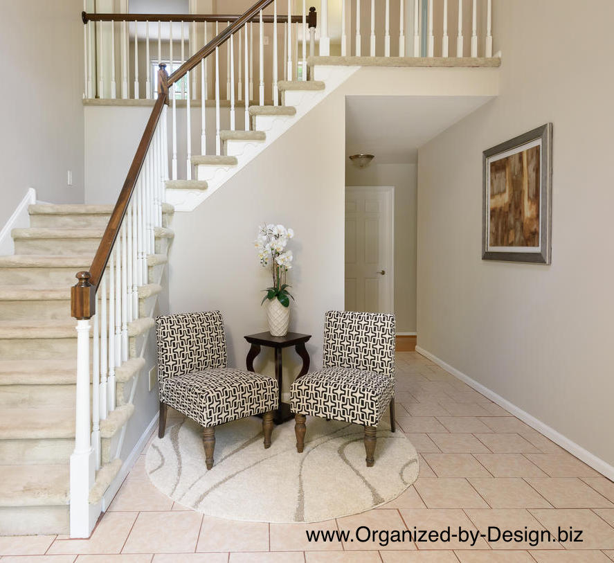Foyer staged with furniture and accessories by Organized by Design